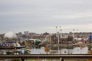 Warm & Bright, SW Exposure 1 Bdrm + Den Suite with Direct False Creek Water Views at the Firenze!