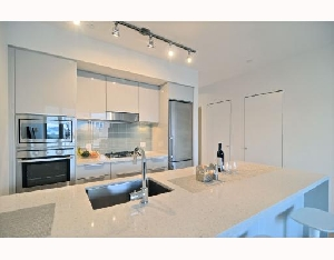 Urban living at EAST, this spacious 822 sq. ft home with 2 bedrooms, 1 spectacular bathroom and a large 100 sq. ft covered balcony