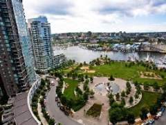 Water Views of False Creek & George Wainborne/David Lam Park in this South East Exposure 1Bdrm + Den in Downtown Vancouver Yaletown.
