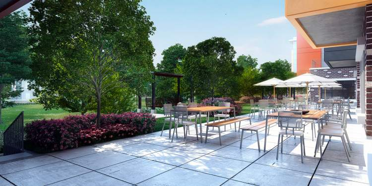 Enjoy some fresh air on the patio at Camellia Residences by ATL Senior Living.