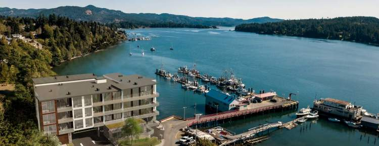 Imagine owning a luxurious oceanfront condominium sitting on the ocean's edge within a protected harbour in a bustling and fast-growing Vancouver Island community.
