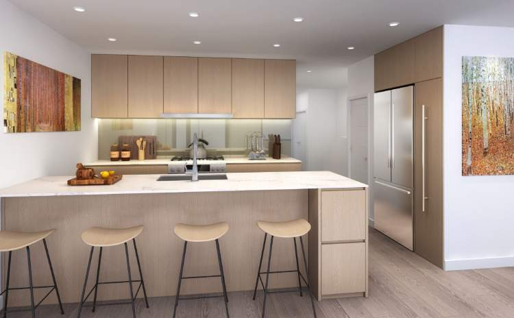 The gourmet kitchen is designed to be versatile – a gathering place for cooking, entertaining and living.