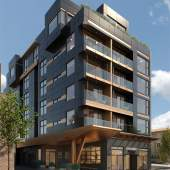 Coming soon to Mount Pleasant, Grand is a modern concrete building located in Vancouver's tech hub.