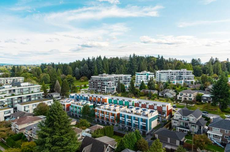 Across from Queen Elizabeth Park, homes feature rooftop patios, terraced balconies, and underground parking.