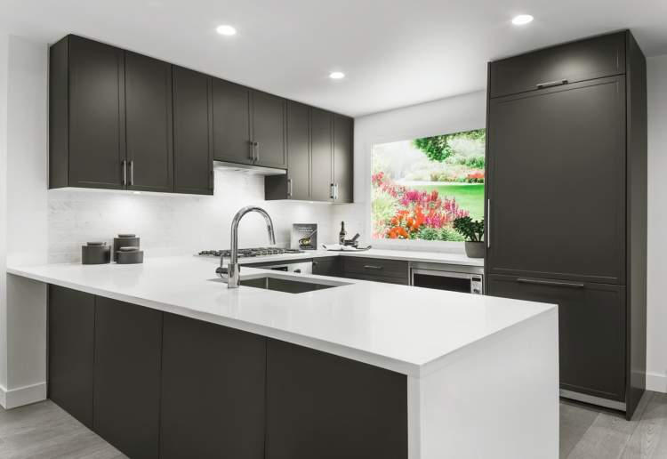 Integrated appliance package including Blomberg refrigerator, Bosch cooktop, Bosch dishwasher, and Bosch wall oven.