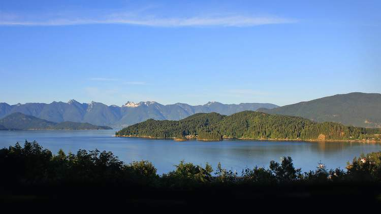 North, South and East facing windows and patios open wide vistas of Howe Sound and the Coast Mountain range.