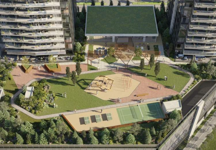 Outdoor amenity area that includes a running track, green spaces, and a playground.