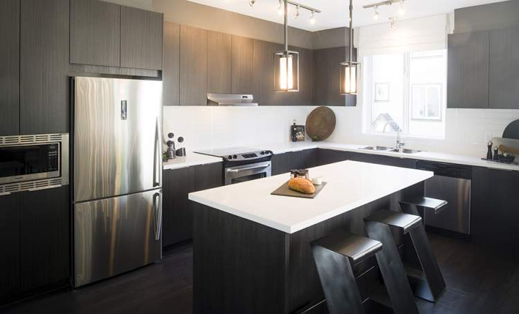 Gourmet kitchens with sleek stainless steel appliances will inspire your inner chef and entice the whole family to gather.