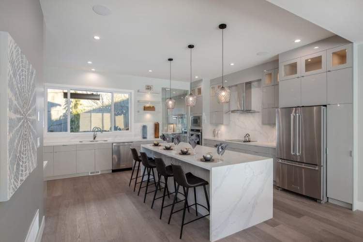 Spacious designer kitchen with Whirlpool appliances for the in-house chef.