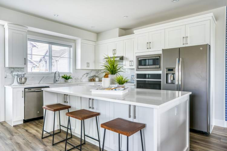 Entertainment-sized kitchens become a family gathering place.