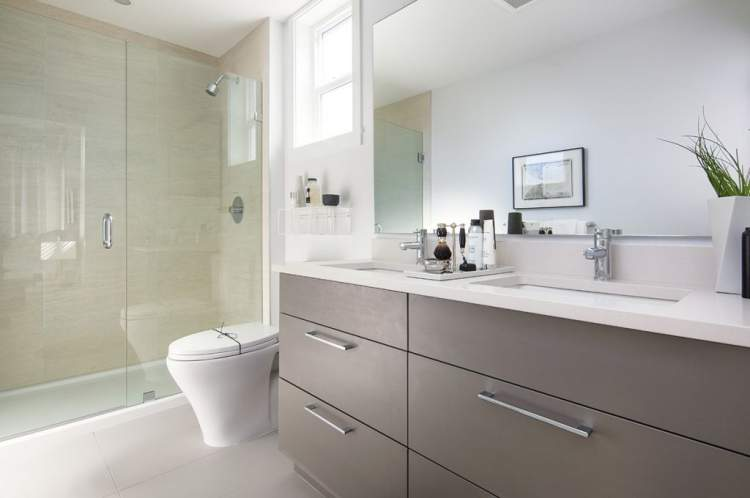 A deep soaker tub adorns the main bathroom with a luxurious frameless glass shower in the master en suite.