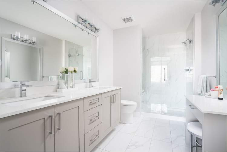 Master en suite includes frameless sliding shower door and floor-to-ceiling Carrara-style porcelain tiles.