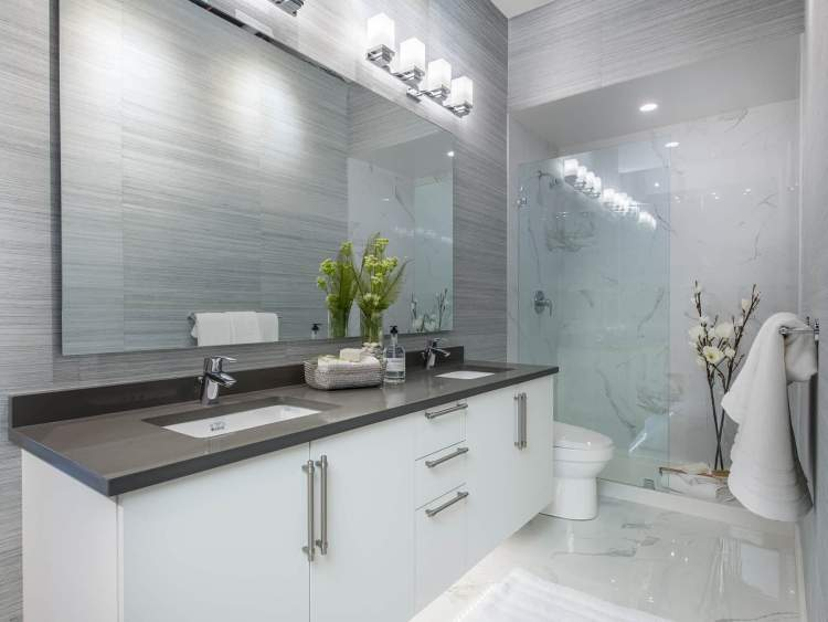 Master ensuite features separate shower with elegant frameless glass enclosure and porcelain tile, generous dual undermount sinks and spacious quartz countertop.