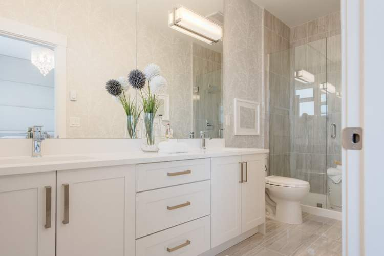 Retreat to the luxurious master en suite with its separate shower with frameless glass enclosure and accent tile, dual undermount sinks and spacious quartz countertop.