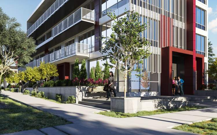 View of Cambie Skyhomes lobby entrance at the corner of West 35th Avenue and Cambie Street.