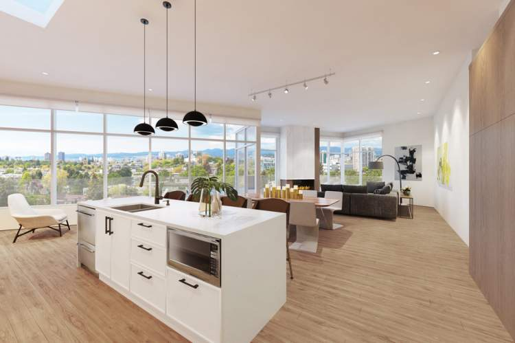 Overheight ceilings open up the spaces to the light that floods in from large, triple-glazed windows.