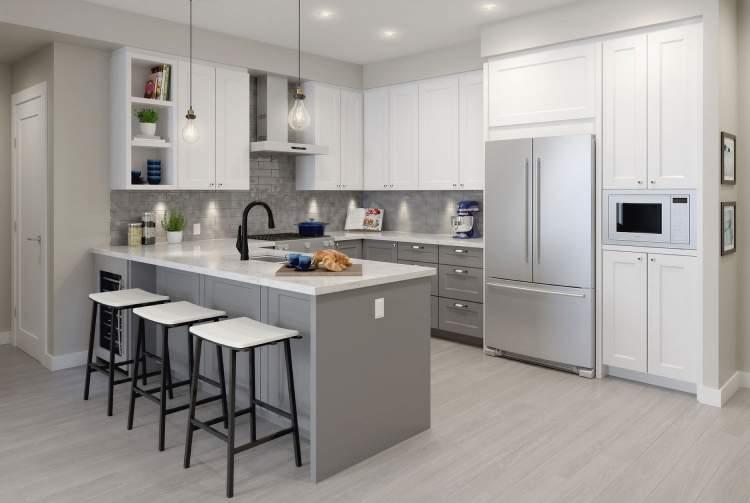 Every kitchen includes a spacious eating bar, polished quartz countertops, gorgeous two-tone cabinetry with LED lighting, and Blomberg stainless steel appliances.