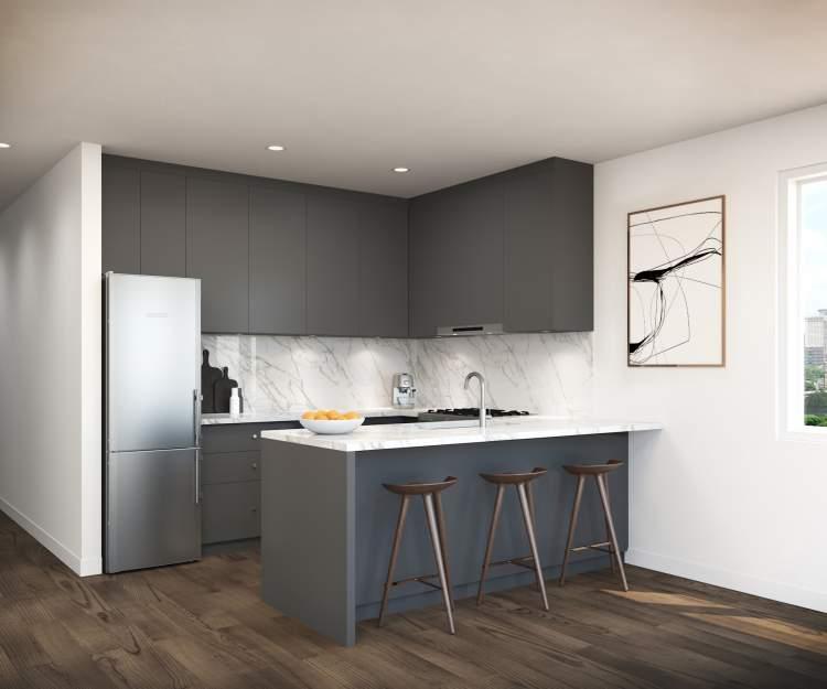 Elegant kitchens feature premium KitchenAid appliance package, Carrara quartz countertops, and maple Shaker cabinets.