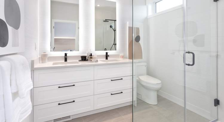 Bathrooms offer traditional Shaker cabinetry with soft-close doors and drawers. En suites feature frameless glass showers.