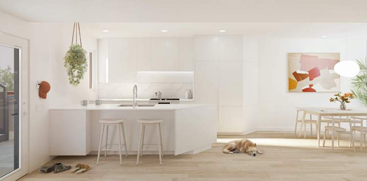 Kitchens have integrated wall cabinets and built-in appliances by Bosch and Blomberg.