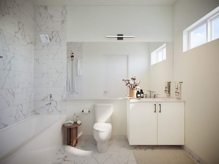 Lizzy Bay bathrooms feature white acrylic cabinets and marble-style tiling.