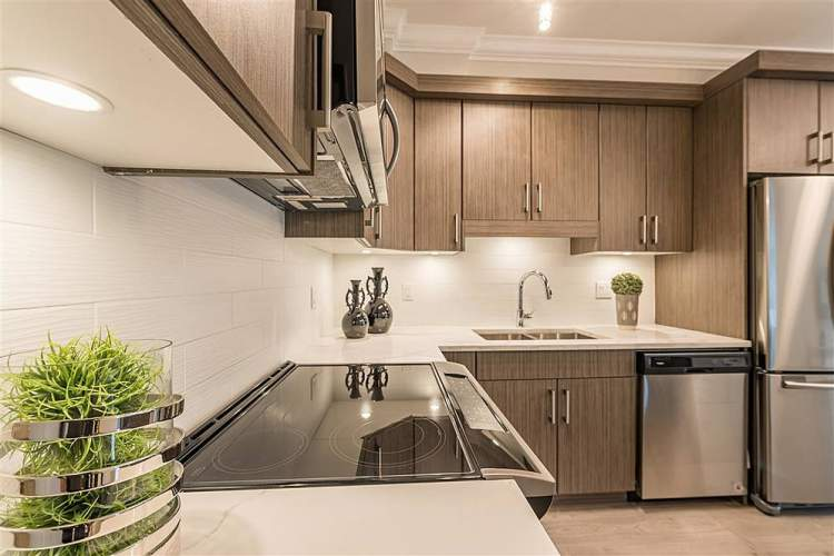 Sophisticated finishes feature stainless steel appliances, soft-close cabinetry, and quartz countertops.