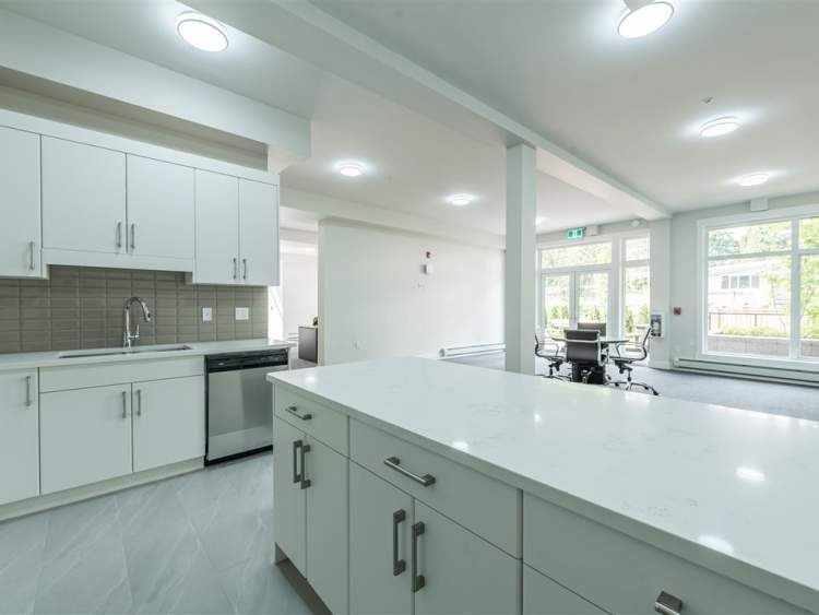 Resident amenities offered include a party room with kitchenette and an adjoining landscaped patio.