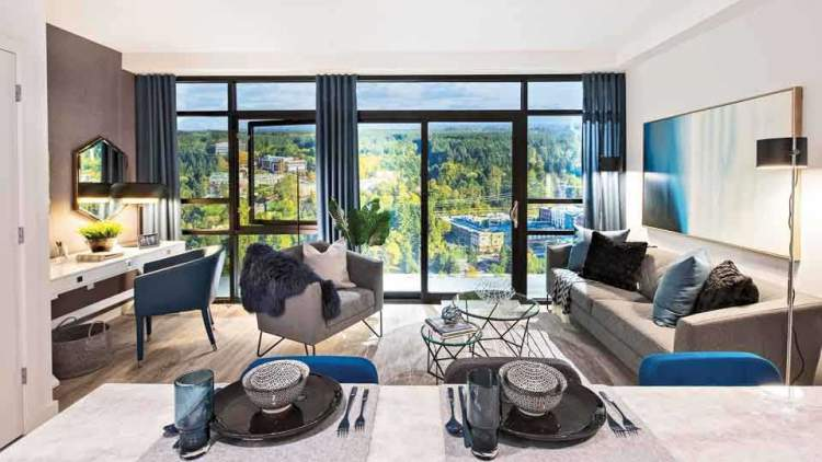 Each unit boasts an abundance of warm wood and natural stone features, and floor-to-ceiling windows to take in the vast views.