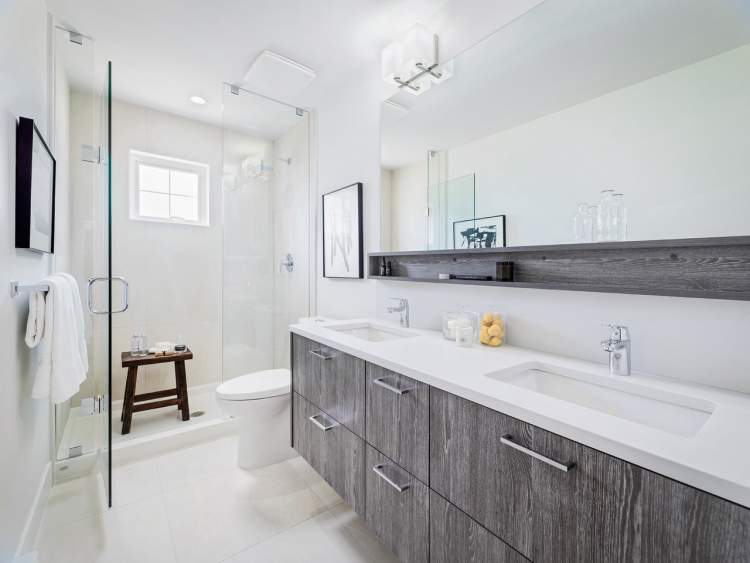 Flat-panel cabinetry and polished chrome hardware and fixtures make for modern bathrooms.