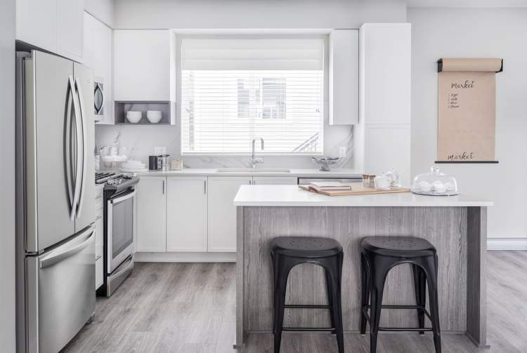 Stainless steel appliances and solid quartz countertops bring a sleek elegance to your kitchen.