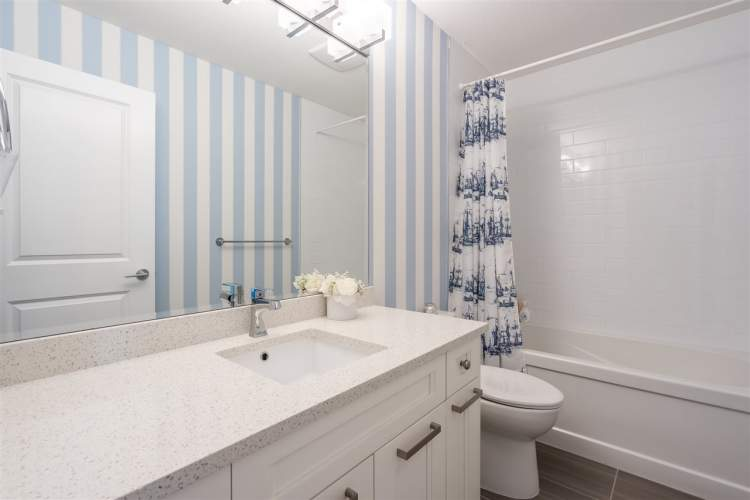 Main bathrooms feature soaker tubs with ceramic tile surrounds, quartz countertops, and contemporary cabinetry.