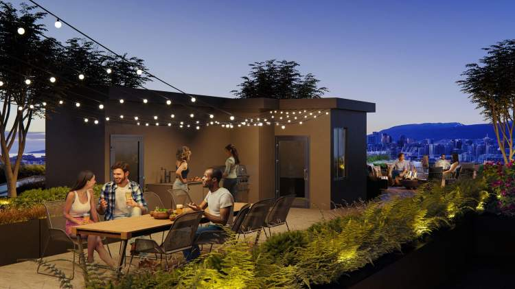 A large rooftop patio featuring spaces to lounge and dine while enjoying the captivating city view.