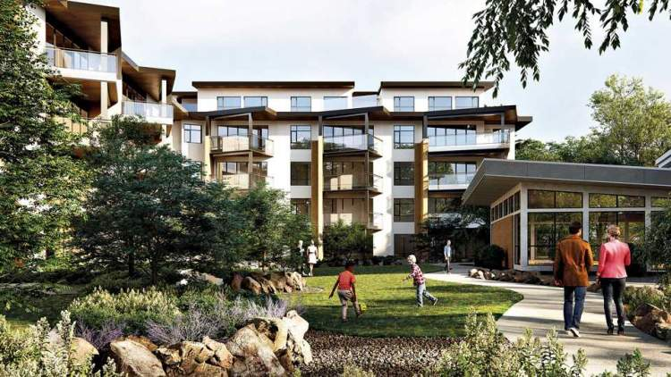 Building amenities include a landscaped courtyard with outdoor seating and a children's play area.