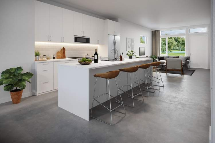 The open concept gourmet kitchen offers modern flat panel cabinetry, pantry, and large island to accommodate four seats.