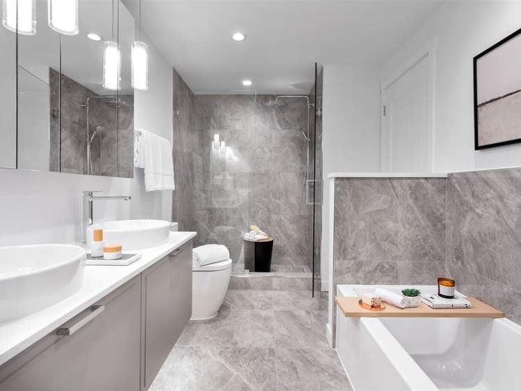 A sophisticated en suite is blanketed in tiles, and features a spacious double vanity and an invigorating shower.