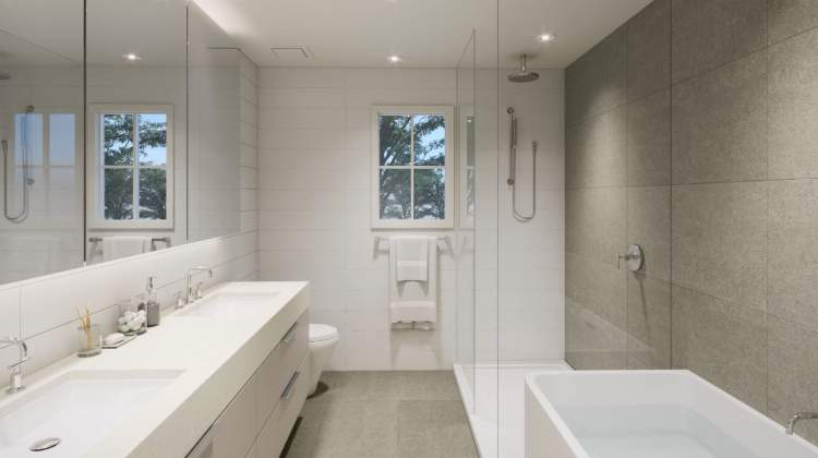 Luxuriously-finished bathrooms feature deep soaker tubs, frameless glass shower enclosures, double vanities, and oversized tiles.