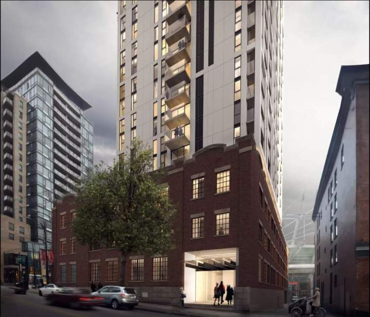 View of Robson from Cambie Street showing restored Northern Electric Company Building where the hotel will be located.