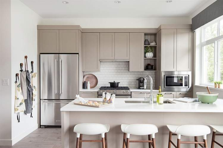 Thoughtful kitchens with oversized drawers, corner cabinet organizers and open shelving for maximized storage.