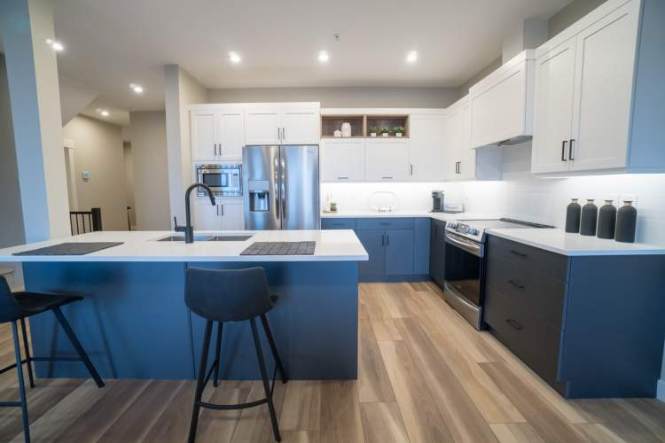 Spacious kitchens make entertaining a delight with premium stainless steel appliances, ample counter space, and large island.