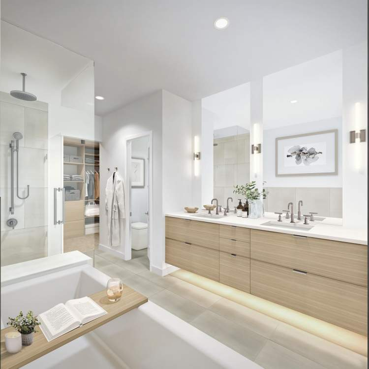 Spa-inspired en suite with tub-shower ensemble and luxurious cabinetry and vanities.