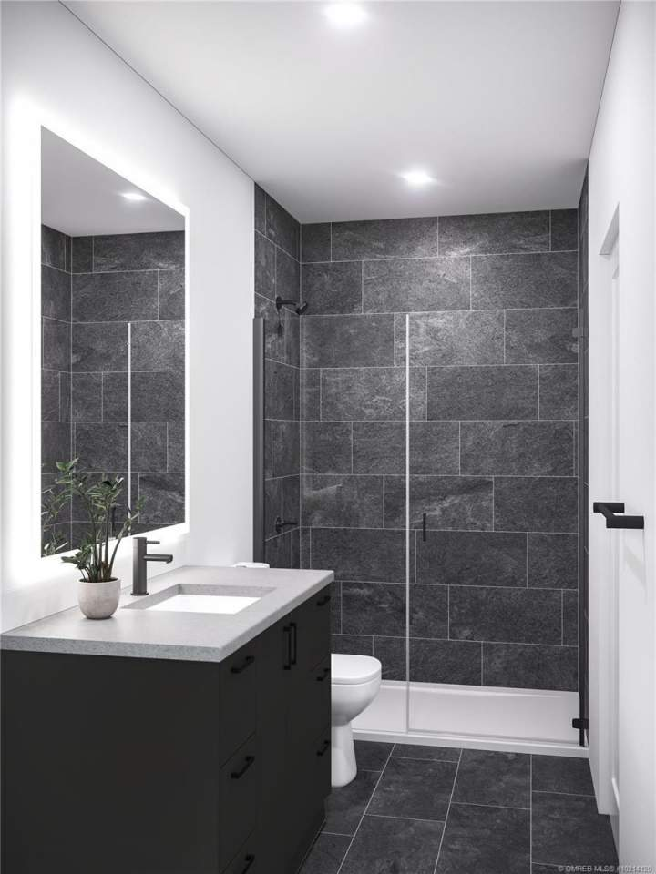 Bathrooms are finished with a choice of two colour palettes by Materia Interior Design. Onyx is shown here.