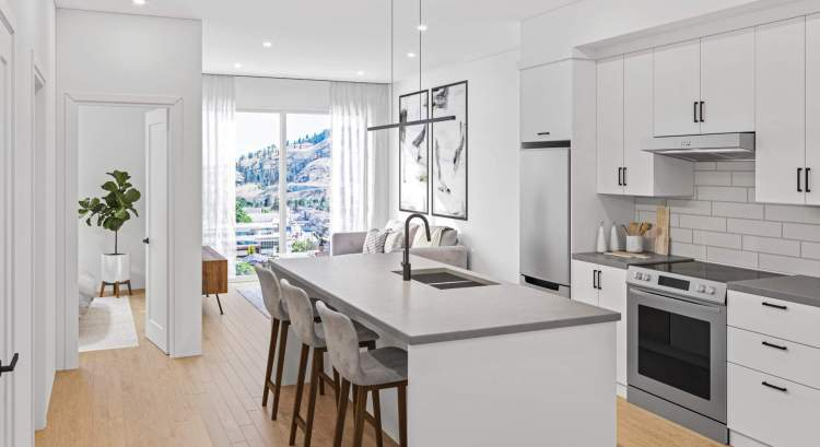 Concrete-inspired quartz countertops, flat-panel cabinetry, stainless steel appliance package.