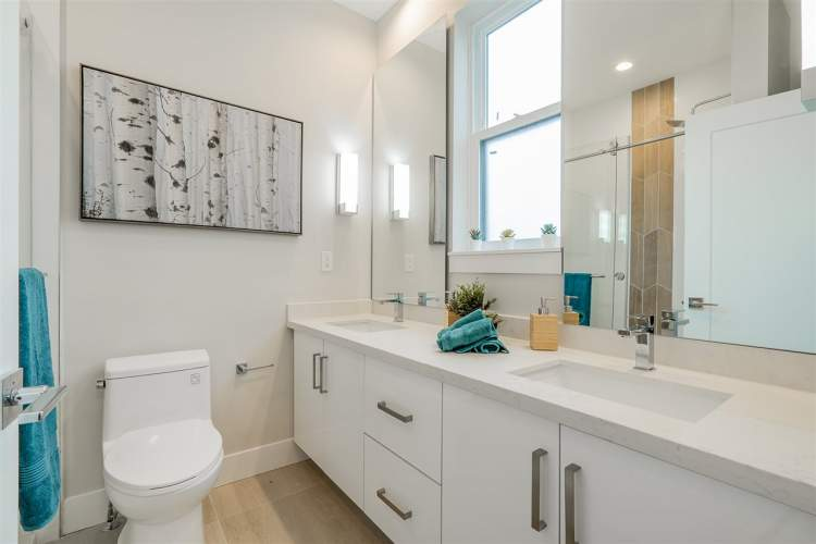 Bathrooms feature heated porcelain tile floors and a comfortable layout.