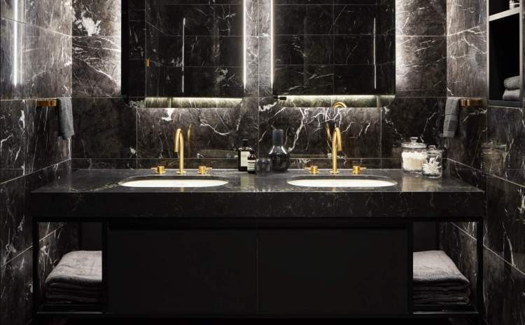 Panther features include 24k gold Graff fixtures, stone floors, Cesar Fenix black cabinets.