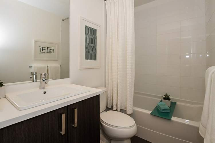 Double sinks with floating vanity, white Shaker cabinetry, and imported quartz countertops make bathrooms beautiful.