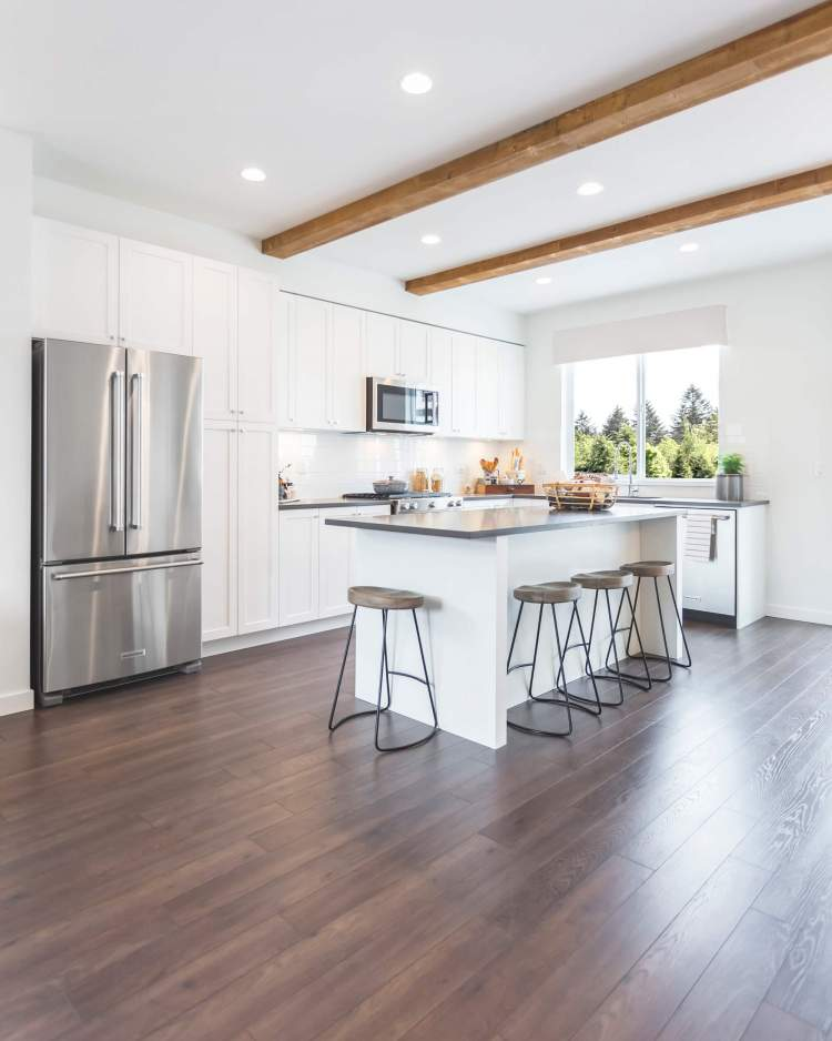 Open-island, oversized kitchens include imported quartz countertops and premium stainless steel appliances.