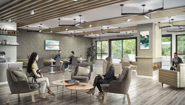 Co-working and social spaces with a fireplace and coffee bar.