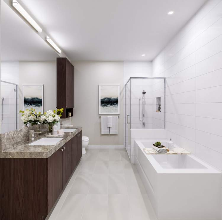 Heated flooring, a frameless glass walk-in shower, and flat-polished vanity mirrors create elegant bathrooms.
