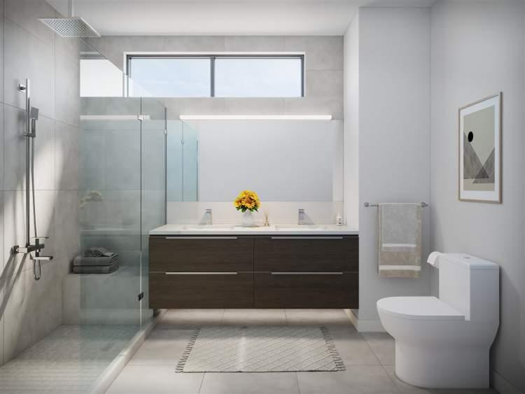 Modern frameless glass shower enclosures, quartz countertops, and large porcelain tiles provide a spa-like tranquility.