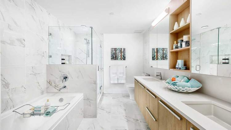 Bathrooms showcase porcelain tile on the floor and walls; wood-like cabinets add a touch of warmth.